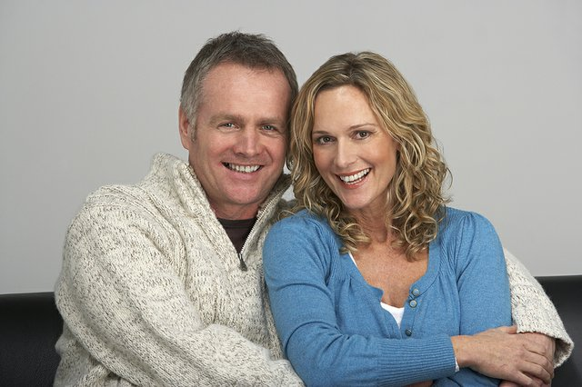 bigstock_Middle_Aged_Couple_Sitting_On__13899617_zps96cacc9a.jpe