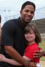 Elvis Andrus hugs a Miracle League player