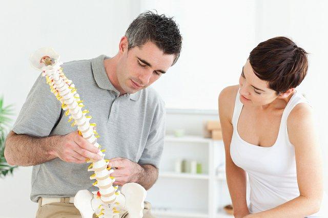 bigstock-Chiropractor-and-patient-looki-23239382.jpe