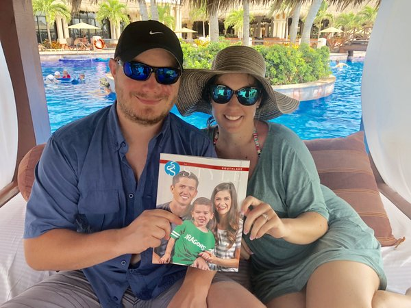Tanner and Kristin Segars on their honeymoon, poolside in Cancun, Mexico.jpg