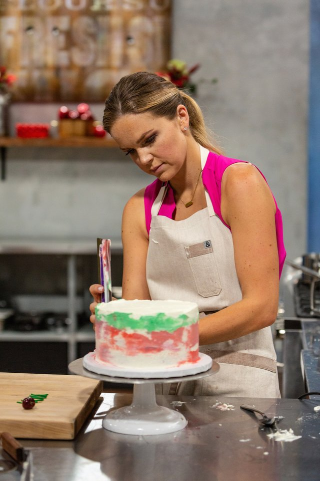 Jessica Colvin decorates her cake, as seen on Spring Baking Championship....jpeg