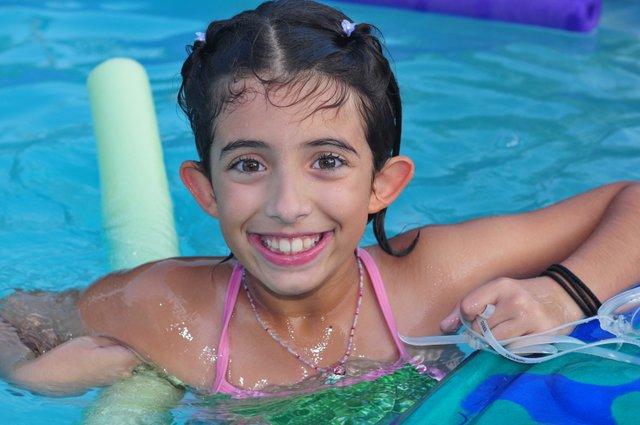 1. Elise Cerami in backyard pool.jpg